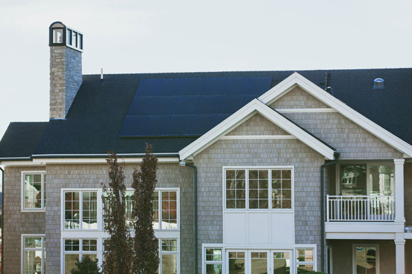 A large house with solar panels on the roof